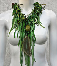 "Load image into Gallery viewer, Suede "" Whip""  Necklace highlighted with Geode stone, Resin & Seeds."