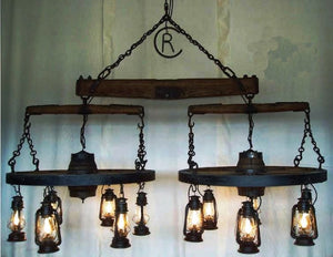 """The Spur"" Wagon Wheel Chandelier"