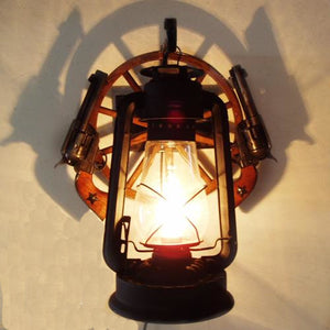 Rustic Wagon Wheel Lantern Wall Sconce with Pistols
