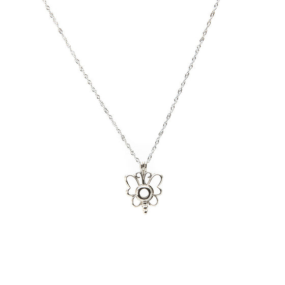 Silver plated Butterfly Cage pendant - Pearl in Oyster - Souk Madinat Jumeirah, Dubai