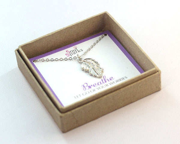 Breathe let go of your worries feather charm silver necklace in a gift box