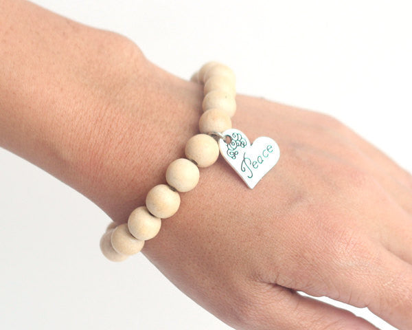 Peace wooden bead bracelet in beige