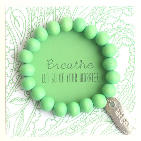 Let go wooden bead bracelet in green