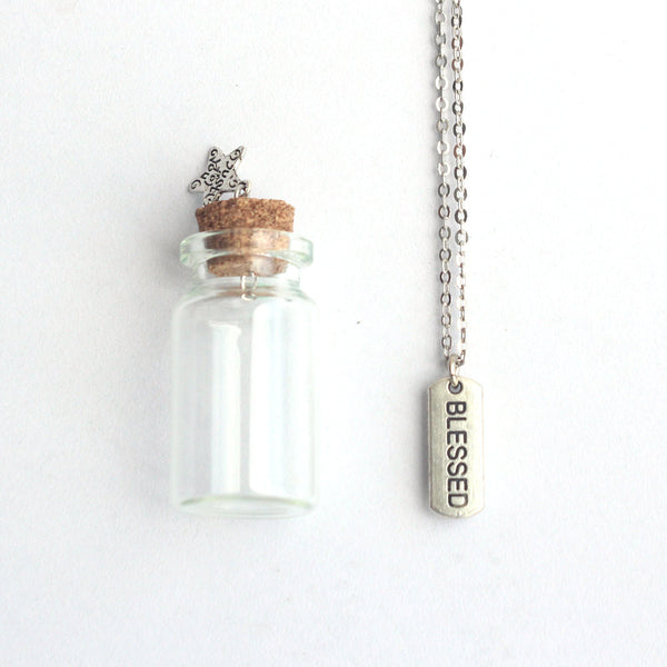 Blessed mantra charm silver necklace in a tiny bottle