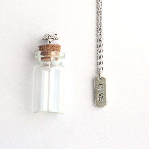 Love mantra charm, silver necklace in a tiny bottle