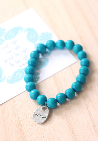 Live light wooden bead bracelet in aquamarine