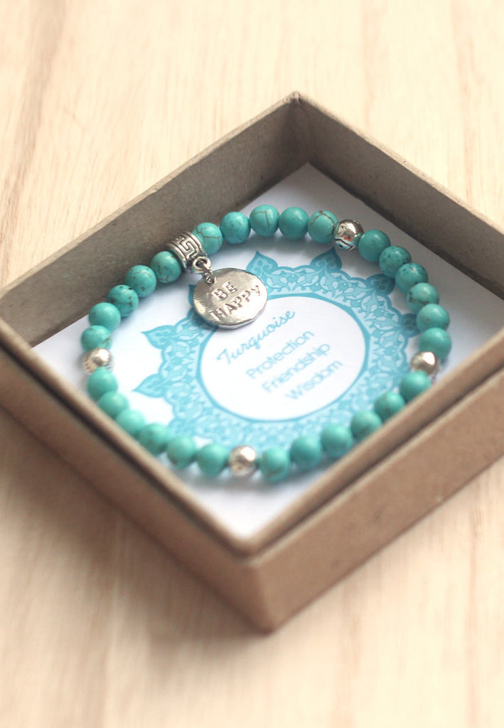 Turquoise, silver evil eye beads, be happy charm bracelet