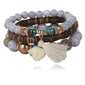buy Wooden Bead Bracelet with Tassel & Elephant Charm Twisted Wire