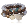 Image of Twisted Wire Multi-Layered Wood & Bead Bracelets with Tassel