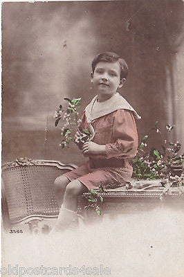 BOY WITH FLOWERS - 1915 COLOUR REAL PHOTO  POSTCARD