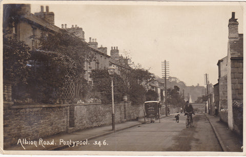 Old real photo postcard of Albion Road, Pontypool in Monmouthshire