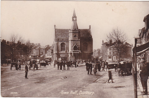 Old postcard showing the Town Hall, Banbury and busy street scene