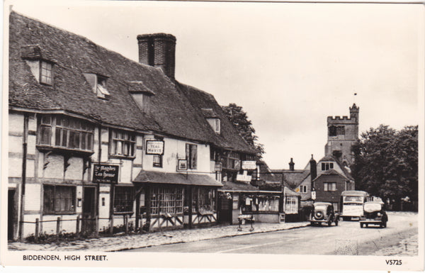 Real photo postcard of Biddenden High Street in Kent