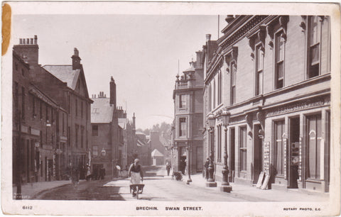 Old real photo postcard of Swan Street, Brechin in Angus, Scotland