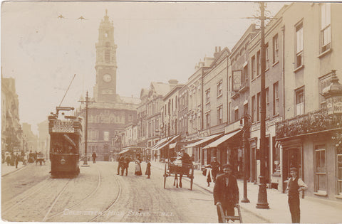 Old real photo postcard of Colchester High Street in Essex