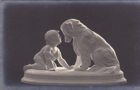 Vintage postcard showing sculpture of dog and child