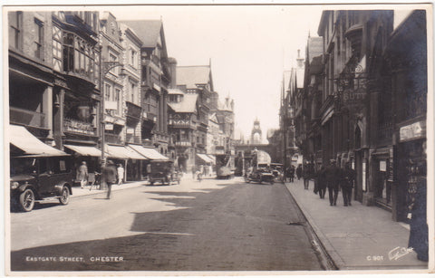 Old real photo postcard of Eastgate Street, Chester