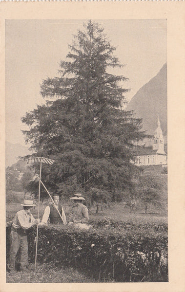 Old postcard showing workers on the land having a break and a chat