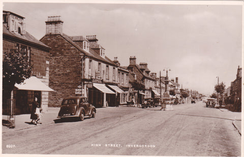 Old real photo postcard of High Street, Invergordon showing old cars