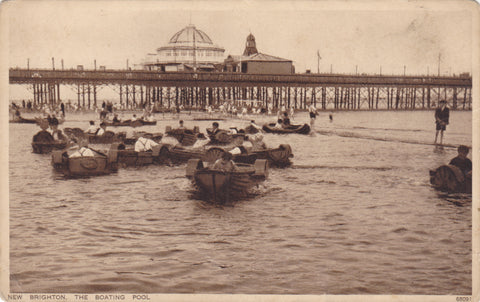 Old postcard of New Brighton Boating Pool with pier in the background