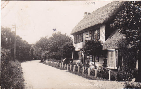 Old real photo postcard of a thatched cottage at North Hayling