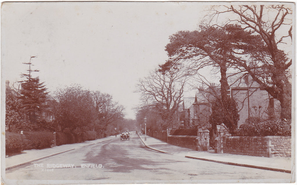 Old real photo postcard of The Ridgeway, Enfield