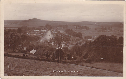 Old real photo postcard showing a view of Stockbridge, Hampshire
