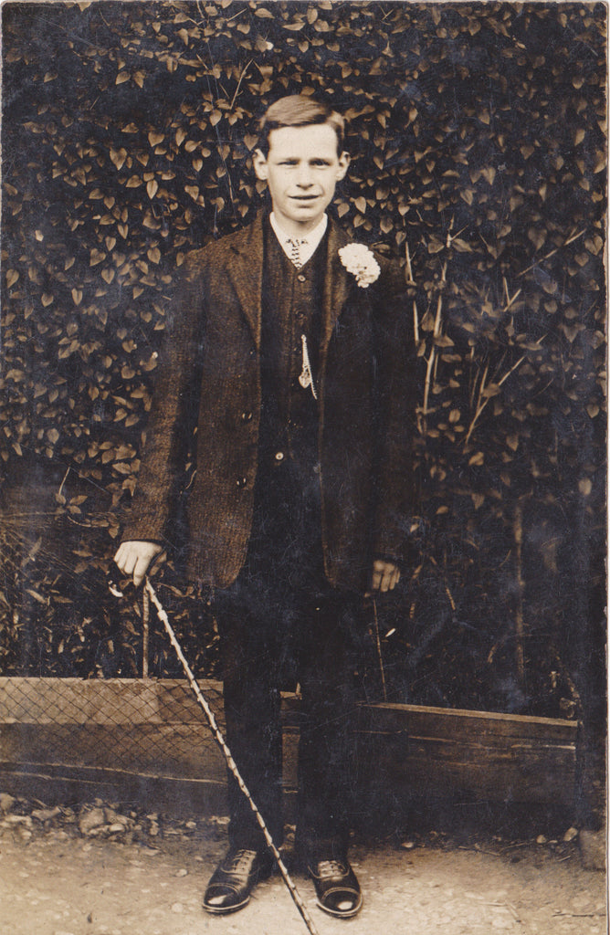 Unidentified man with walking stick