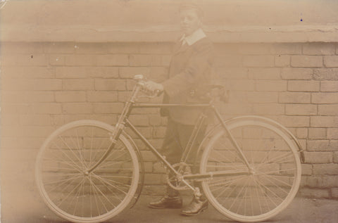Real photo postcard of unknown young man with bicycle