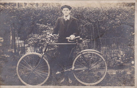 Young man with bicycle, old real photo postcard