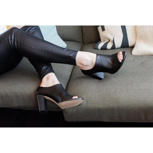 Black Anasa Vegan Shoes Heels by Bahatika on a sofa from the right at ALIVE Boutique