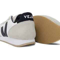 Pair of Vegan Men's Shoes and their sole in White by Veja at ALIVE