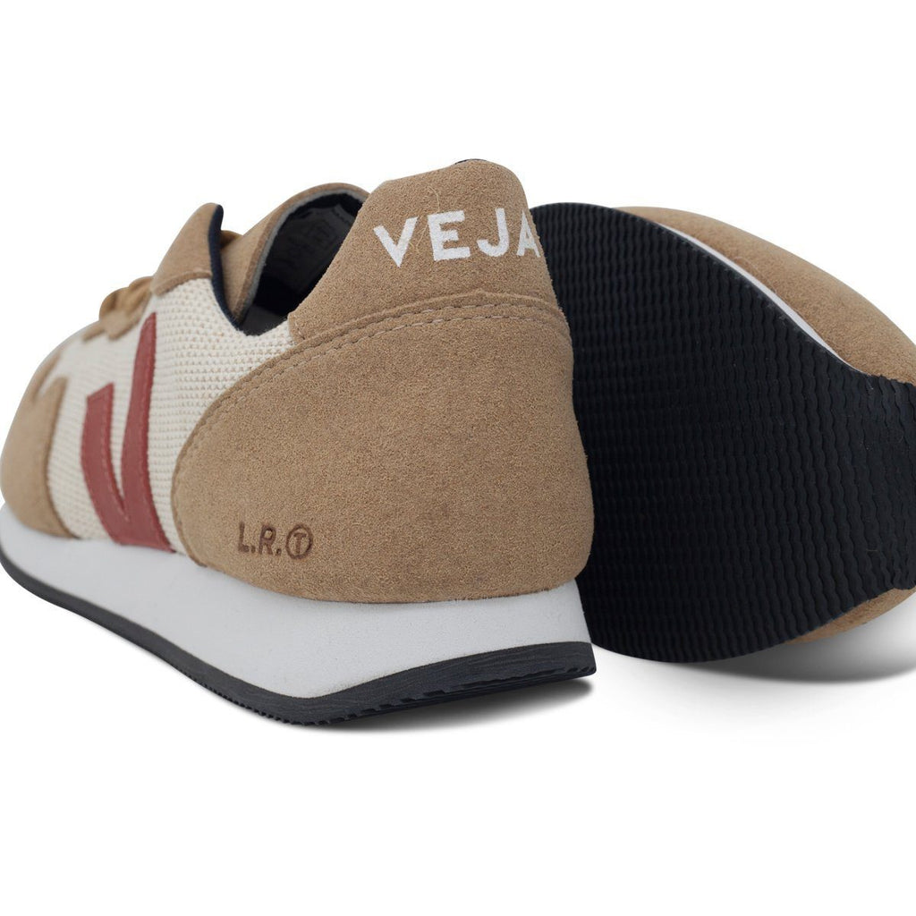 Pair of Vegan sneakers in beige and its sole by Veja at ALIVE Boutique