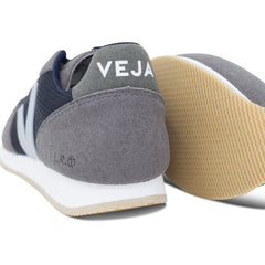 pair of Vegan Shoes in Black Graphite and their sole by Veja at ALIVE Boutique