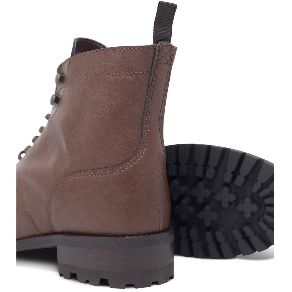pair of Vegan Work Boots in Dark Brown and its sole by Will's Vegan Shoes