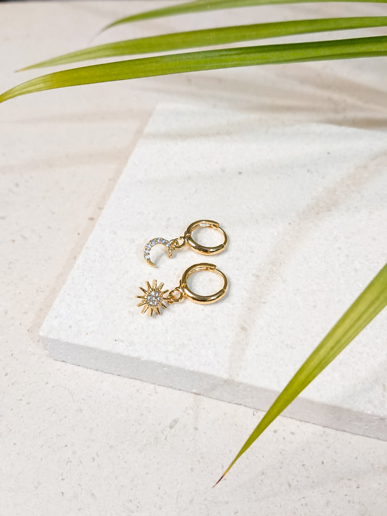 mismatched gold huggies with sun and moon, modern jewellery classics