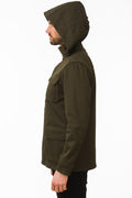 Side of One Man Outerwear dark olive green waterproof field jacket
