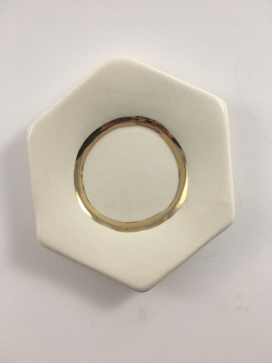 white hexagon dish with golden ring