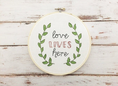 love lives here embroidery wall art