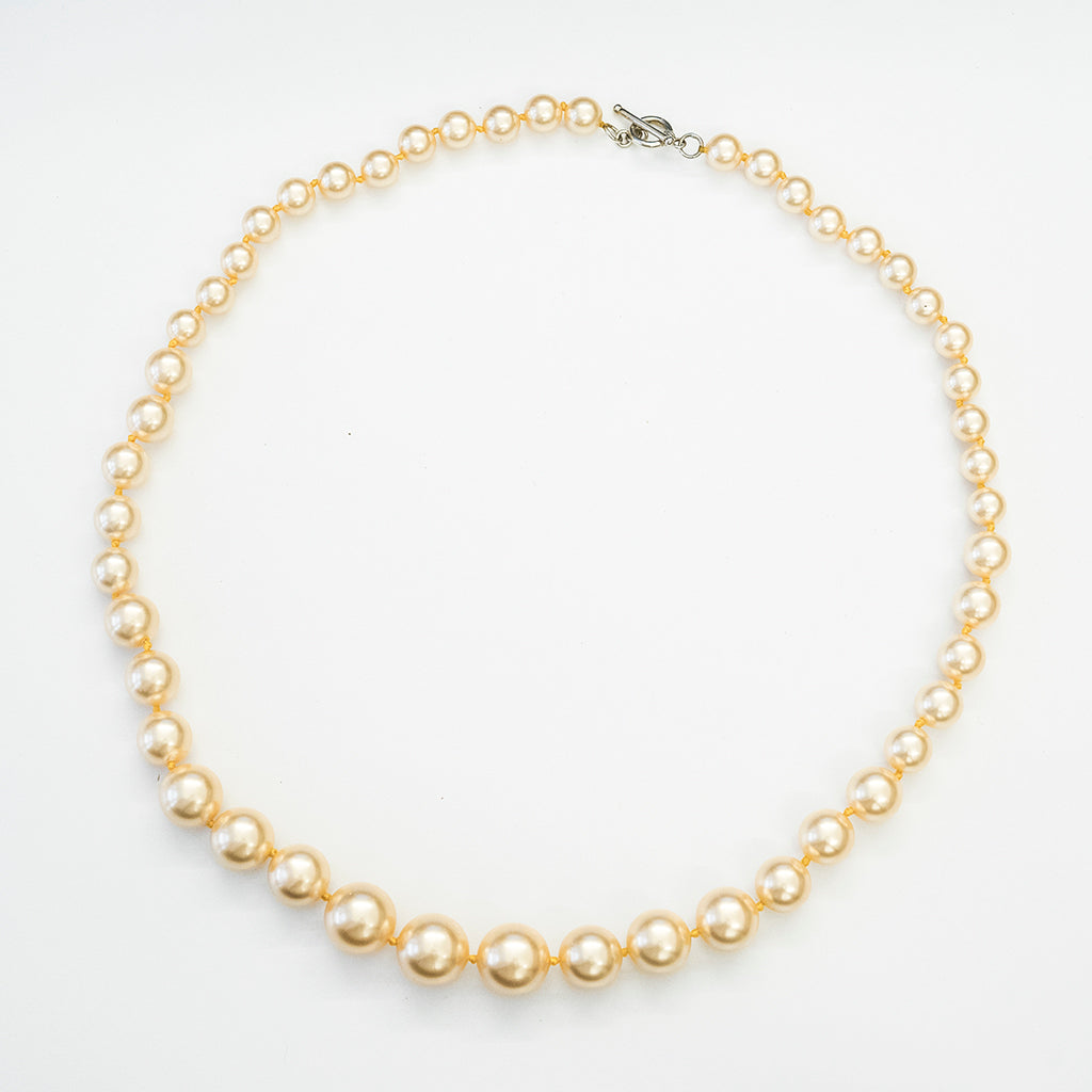 Apricot Pearl Graduated necklace with Antique Toggle Clasp  28""