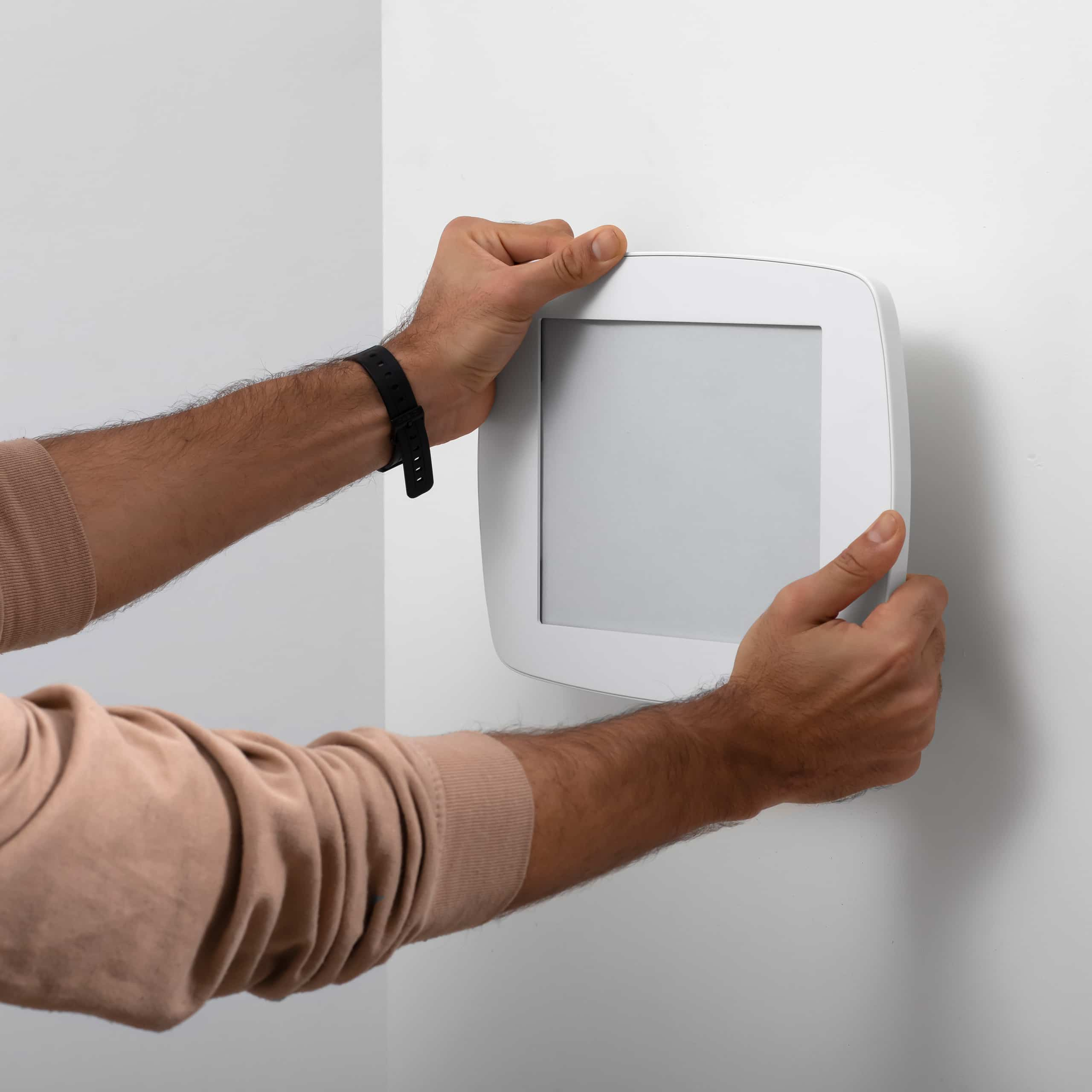 Bouncepad Vesa mounted to the wall, white color, front view