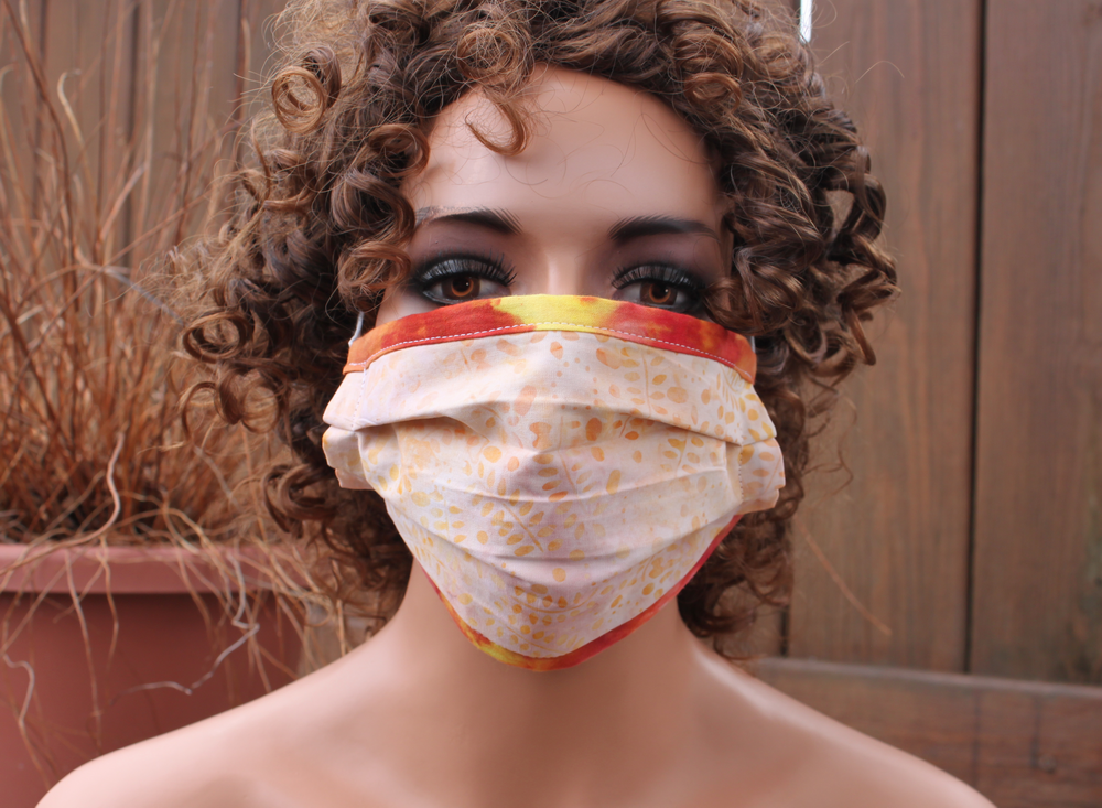Fabric face mask with Elastic - Peach leaves orange