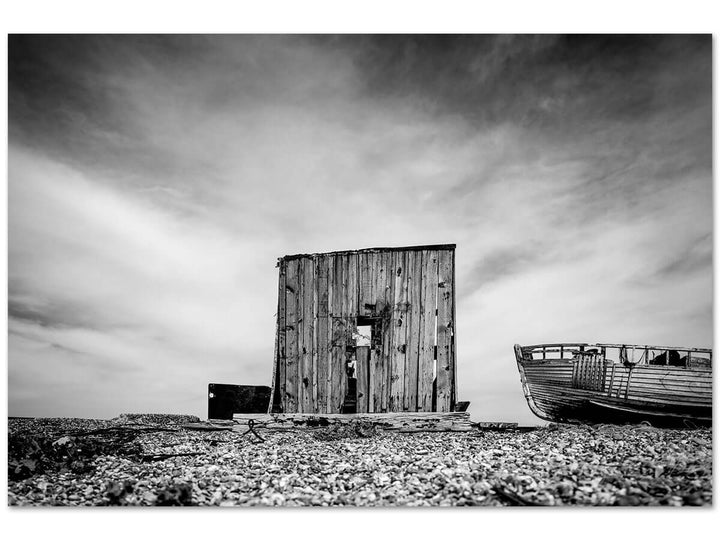 Weathered wooden cabin and old boat at Dungeness