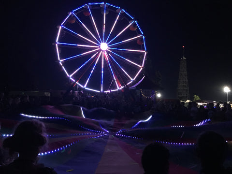 LED ferris wheel with LED strands custom patterns roochute groovechute parachute at music festival pretty lights