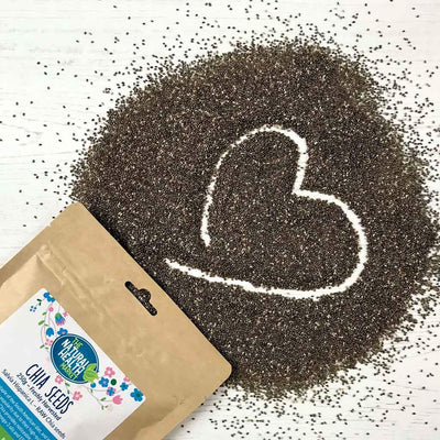 Chia seeds by The Natural Health Market in the shape of a heart.