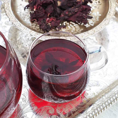 Organic hibiscus tea brewing in a cup by The Natural Health Market