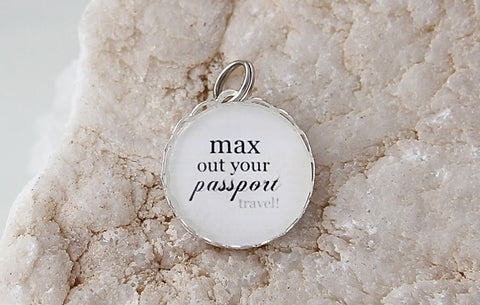 Max Out Your Passport Bubble Charm