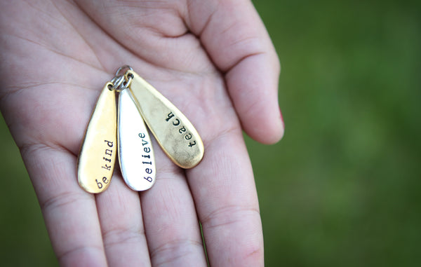 Hand Stamped Gold Teardrop Believe Charm