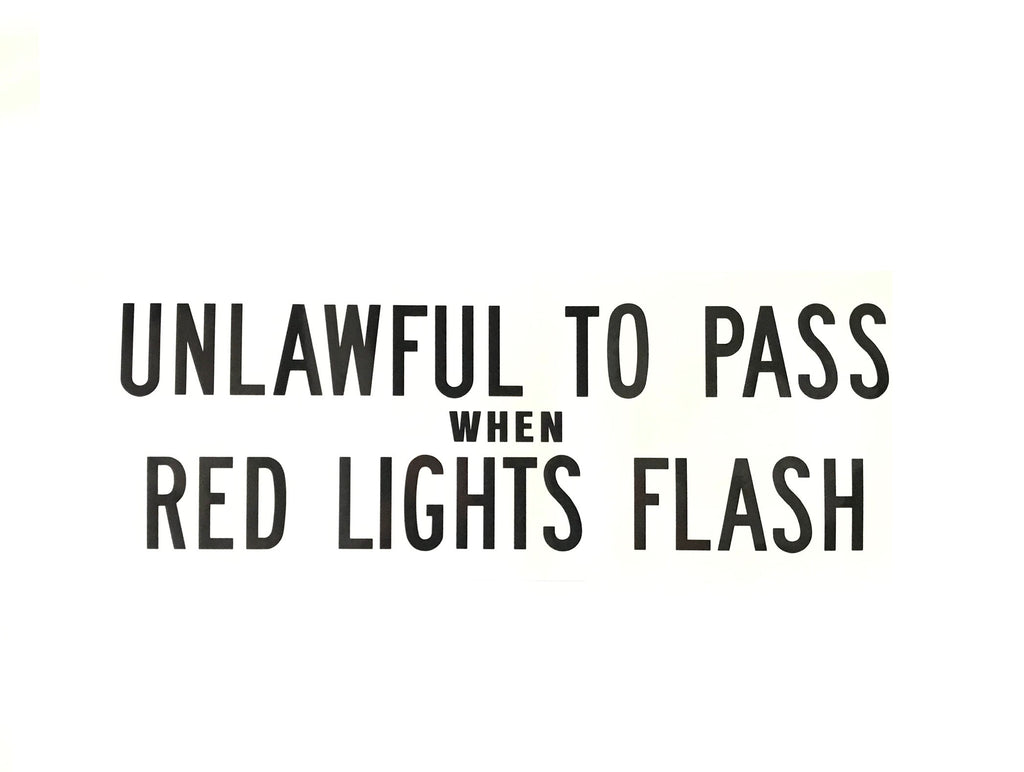 Decal - Unlawful to Pass When Red Lights Flash (Black Letters)