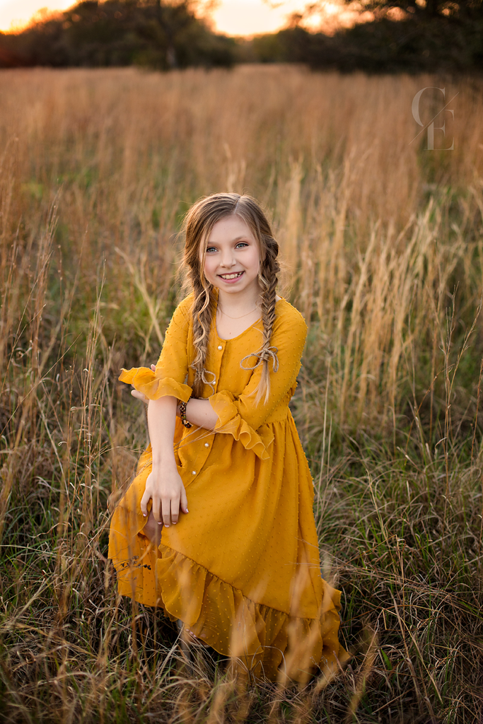 Mara mustard yellow high low dress in field of grass boho photoshoot - Belle & Kai